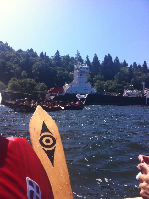 Kinder Morgan in the background. Tsleil Waututh paddle in the foreground.
